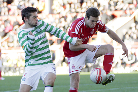 Celtic win over Aberdeen, as Dons fans show ugly side.